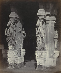 Madura. Trimul Naik's Portico. Two monolithic pillars at East Entrance [of Pudu Mandapa]